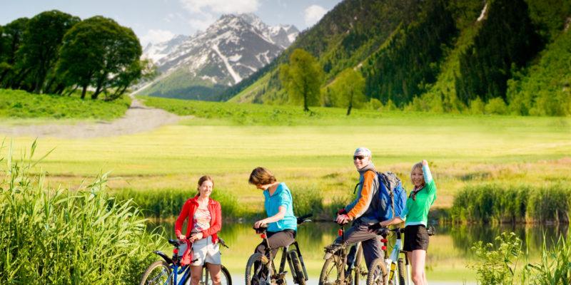 Cyclists biking outdoors